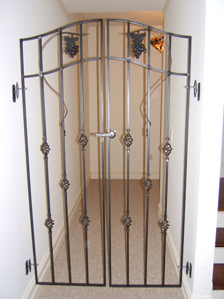 Exceptional Custom Interior Arched Iron Hallway Gate, With Basket/Grape Details