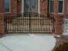 Custom Iron Double Pedestrian Arched Patio Gate with Scrolls and Finials