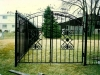 Double Wrought Iron Arched Pedestrian Garden Gate with Scrolls and Finials Design
