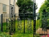 Custom Wrought Iron Arched Double Garden Gate with Finials and Ornamental Scrolls