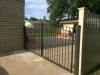 Custom Wrought Iron Arched Gate, Tan Vinyl Closed Picket Fence-See Vinyl Fence and Iron Gates Categories.