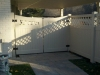 Tan Kingston Vinyl Privacy Fence with Double Pedestrian Concave Gate, and Customized Lattice Top Design on Both