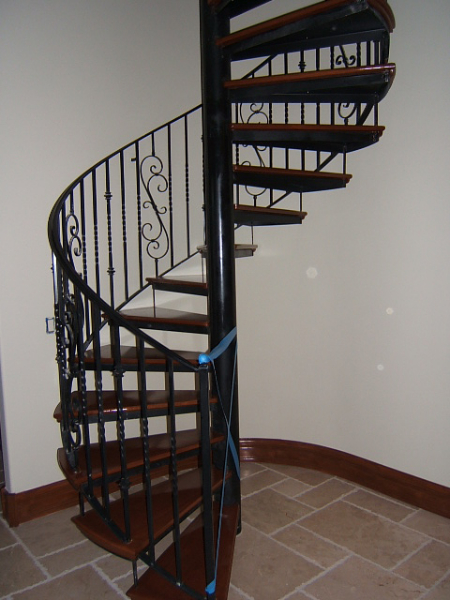 Wrought iron spiral staircase along with white floating - Spiral staircase wrought iron ...