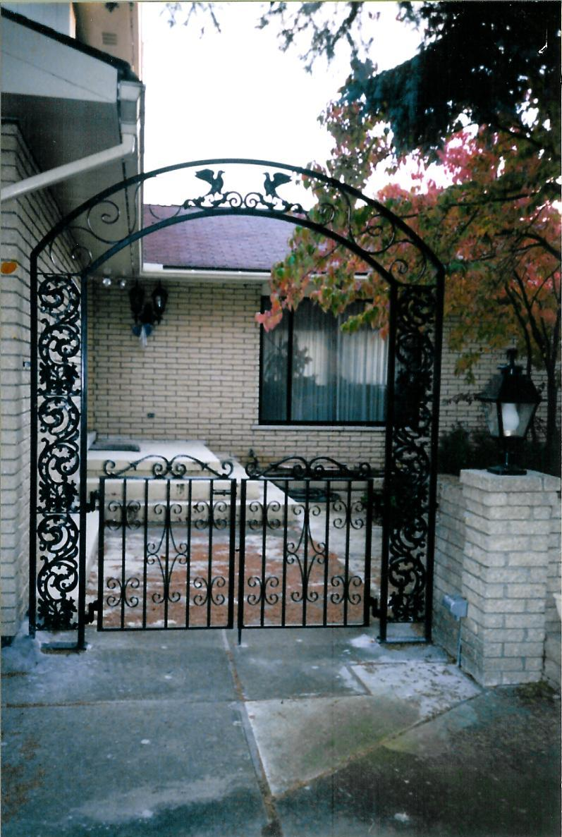 Custom Iron Arch with Double Pedestrian Gates